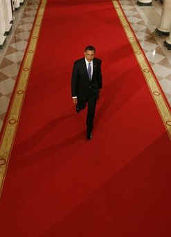President Barack Obama in the Cross Hall of the White House on his way to speak at a prime time press conference on the 100th day anniversary of his presidency on April 29, 2009.