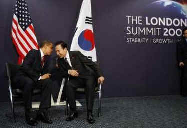President Barack Obama meets with South Korean President Lee Myung-bak at the Excel Centre in London