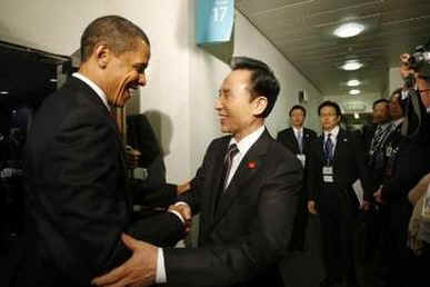 President Barack Obama meets with South Korean President Lee Myung-bak at the Excel Centre in London.