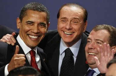 President Obama gestures during the G20 group photo with Russian President Medvedev and Italian Prime Minister Berlusconi.