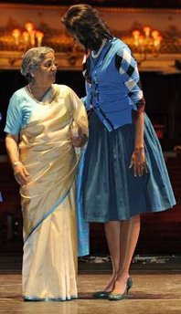 Michelle Obama with the wife of India's Prime Minister Singh. First Lady Michelle Obama joins Sarah Brown, the wife of UK PM Brown, and other spouses of G20 leaders at a special performance of Giselle at the Royal Opera House in London on April 2, 2009.