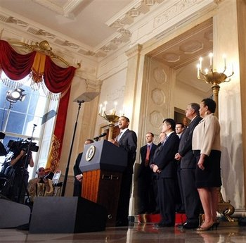 President Barack Obama speaks on the auto industry in the Grand Foyer of the White House on April 30, 2009.