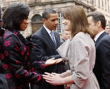 President Barack Obama and First Lady Michelle Obama are greeted by French President Sarkozy and his wife Carla Bruni-Sarkozy at the Palais Rohan in Strasbourg, France.