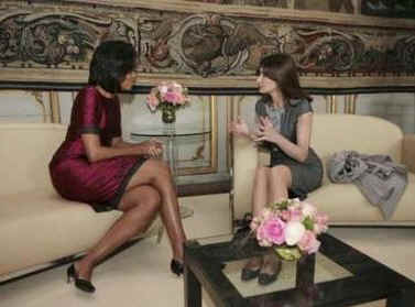 Michelle Obama and Carla Bruni-Sarkozy get to know each other in a private palace meeting room.