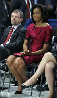 First Lady Michelle Obama listens to the President speak at a town hall style meeting with a young German and French audience at the Rhenus Sports Arena in Strasbourg, France.