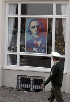 Police officer looks at the Obama poster as he walks in the Baden-Baden market area prior to Obama's arrival on April 3, 2009.