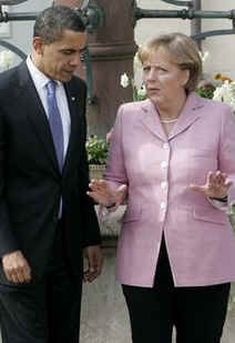 President Obama and Chancellor Merkel talked as they strolled through the market on their way to a welcoming ceremony.
