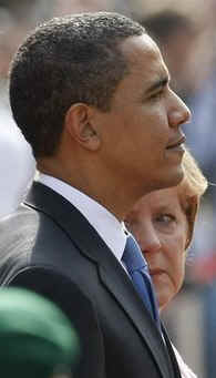 President Barack Obama and German Chancellor Angela Merkel pause for the national anthems of the US and Germany.