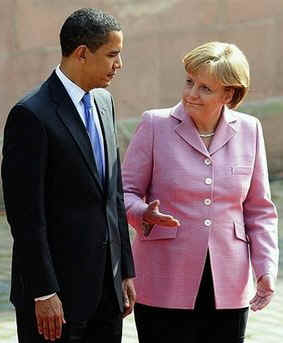 President Barack Obama joins German Chancellor Angela Merkel to inspect a German Military Honour Guard.