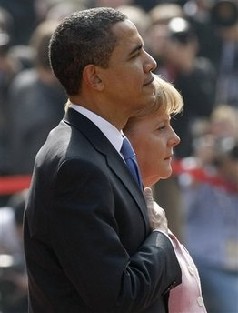 President Barack Obama and German Chancellor Angela Merkel pause for the national anthems of the US and Germany