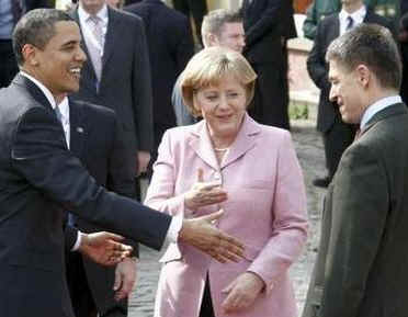 President Barack Obama and First Lady Michelle Obama are cheered by the crowd, and welcomed by German Chancellor Angela Merkel and her husband Joachim Sauer (photo) in the market at Baden-Baden, Germany on April 3, 2009.