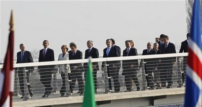 President Barack Obama and the NATO leaders walk in a ceremonial crossing of the Passarelle Mimram (Two Banks) Pedestrian Bridge from Kehl, Germany to Strasbourg, France on April 4, 2009.