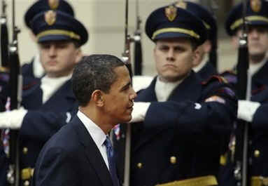 President Obama inspects a Czech honor guard after his arrival at the medieval Prague Castle.
