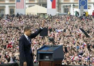 President Barack Obama waves after he delivers a speech to an estimated 25,000 people in Hradcanske Square in the Old City part of Prague, the capital of the Czech Republic.