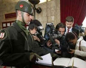 Photographers after President Barack Obama signs the Memorial Book in the Anitkabir Mausoleum in Ankara, Turkey on April 6, 2009.