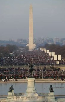 Early morning crowds fill the National Mall around the Washington Monument down to the Lincoln Memorial.