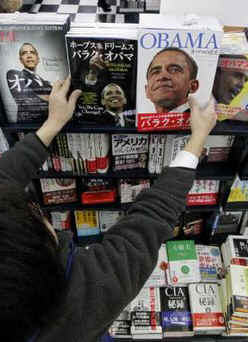 Woman looks at Barack Obama biographies at Tokyo, Japan bookstore on Obama's inauguration day, January 20, 2009.
