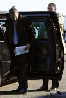 President-elect Barack Obama drops his Blackberry while getting out of his limousine on January 16, 2009.
