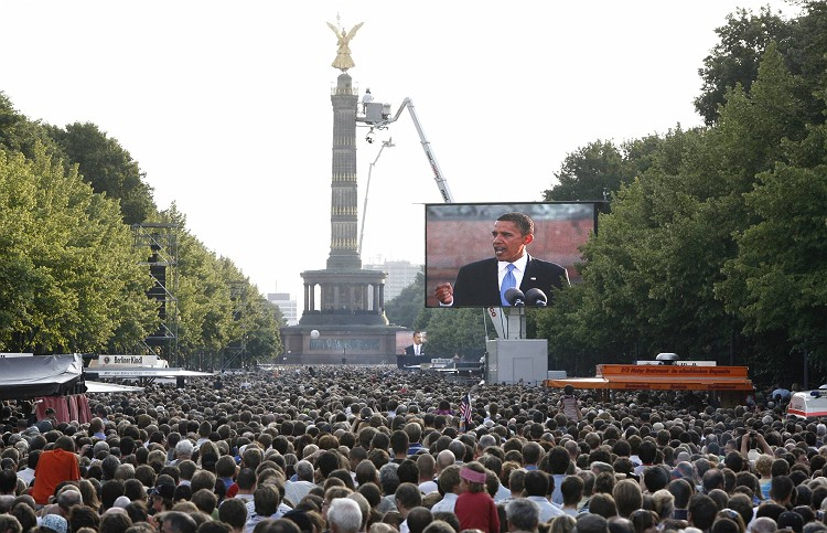 Senator Barack Obama gives a speech in front of hundreds of thousands of Berliners. Barack Obama called on Europe and the United States to stand together again during his Berlin, Germany speech on July 24, 2008. Obama's Berlin speech. in front of the Victory Column, was his only public speech on European tour which included a trip to London.