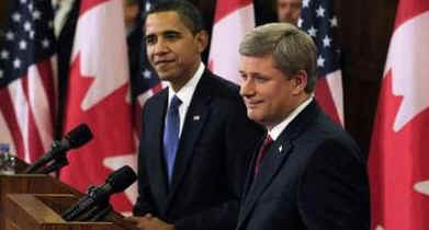 President Barack Obama and Prime Minister Stephen Harper hold a news conference on Parliament Hill after private meetings.