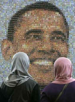 Women look at Obama motif made of stamps at The Jakarta, Indonesia International Stamp Exhibition on November 26, 2008.