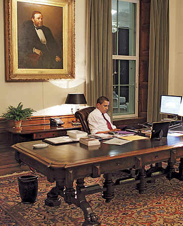 US President Barack Obama reads letters in the Residence Office of the White House. Photo � Time 2009.