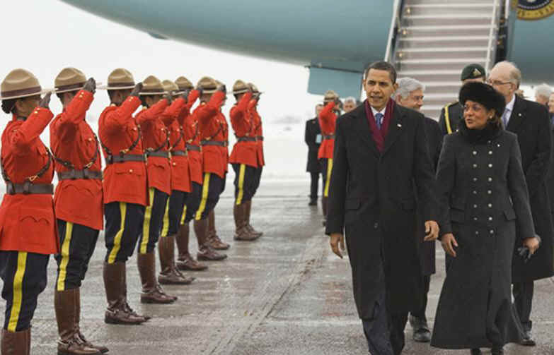 President Obama is greeted at the airport by Canadian governor General Michaelle Jean and RCMP officers. President Barack Obama packs a busy schedule for his one-day visit to Ottawa, Canada on February 19, 2009.
