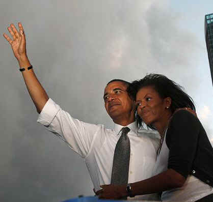 Michelle Obama hugs Barack at a presidential campaign rally at Bicentennial Park in Miami, Florida on October 21, 2008.