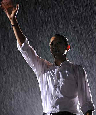 Obama waves to supporters at a university campaign rally in Washington, VA, on a wet September 27, 2008.