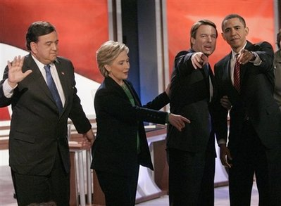 Democratic hopefuls point to audience after debate in Manchester, New Hampshire on January 5, 2008. Eleven months later Clinton and Richardson would receive cabinet posts from Barack Obama.