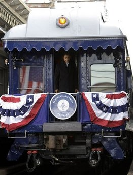 Barack Obama takes the same train journey as President Abraham Lincoln from Philadelphia to Washington on a 137 mile whistle stop trip. Obama's train, known as the Obama Express, stopped in Wilmington, Delaware to pick up Joe Biden, and a stop in Baltimore where he delivered another speech. Abraham Lincoln delivered over 100 speeches on his 1861 train journey.