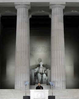 Obama has often posed or spoken in front of two pillars or columns. These pillars appear as the number 11. Obama speaks between twin pillars at the pre-inauguration ceremonies on January 18, 2009 at the Lincoln Memorial.