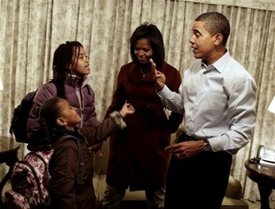 Barack and Michelle Obama get Sasha and Malia ready for their first day of school at Lower School Campus of Sidwell Friends in Bethesda, Maryland on January 5, 2009. Obama and his family are staying at the Hay-Adams Hotel in Washington, DC.