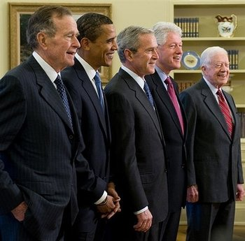 President George W. Bush and President-elect Barack Obama with former Presidents George Bush Sr., Bill Clinton, and Jimmy Carter. President-elect Barack Obama poses for the cameras with the the four living US Presidents in the Oval Office of the White House on January 7, 2009.