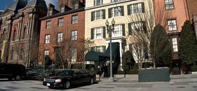 Secret Service vehicles guard the entrance to Blair House where the Obama family moves to on January 15, 2009.