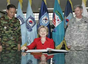 Secretary of State Clinton signs Guest Book with the Commander of US Forces for South Korea General Walter Sharp (right) at Yongsan Garrison in Seoul, South Korea