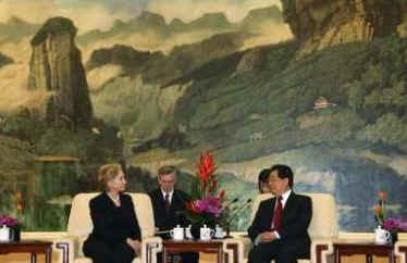 Clinton meets with Chinese President Hu Jintao at the Great Hall of the People in Beijing.