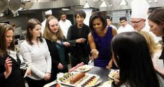 First Lady Michelle Obama meets with White House Executive Chef Cristeta Comerford and the White House kitchen staff to preview the meals for the Governors Dinner in the State Dining Room later that evening.