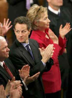 Hillary Clinton and Tim Geithner applaud President Barack Obama after he addresses the Joint Session of Congress at the Capitol in Washington on February 24, 2009.