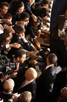 President Barack Obama meets attendees after he addresses the Joint Session of Congress at the Capitol in Washington on February 24, 2009.