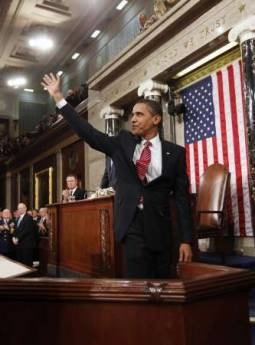 President Barack Obama waves after he addresses the Joint Session of Congress at the Capitol in Washington on February 24, 2009.