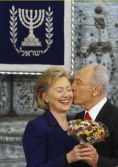 Secretary of State Hillary Clinton gets a kiss from Israeli President Shimo Peres in Jerusalem on March 3, 2009.