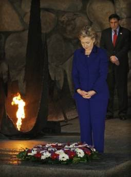 Secretary of State Hillary Clinton lays a wreath at the Yad Vashem Holocaust Hall of Remembrance and wrote a message in the museum guest book.