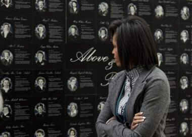 First Lady Michelle Obama visits and speaks at the Arlington National Cemetery for Women in Military Service for America Memorial Center in Arlington, Virginia.