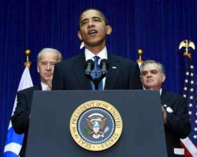 President Barack Obama joins with Vice-President Joe Biden and Transportation Secretary Ray LaHood at the Department of Transport in Washington on March 3, 2009.