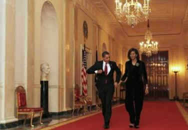 President Barack Obama and First Lady Michelle Obama in the Cross Hall on their way to a dinner for Congressional Heads in the East Room of the White House on March 4, 2009.