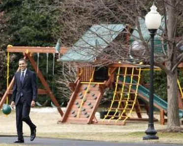 President Barack Obama leaves the White House and passes by the new outdoor play set purchased for Sasha and Malia.