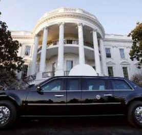 "President Obama's limousine known as ""The Beast"" sits outside the South Portico of the White House after Obama's return."
