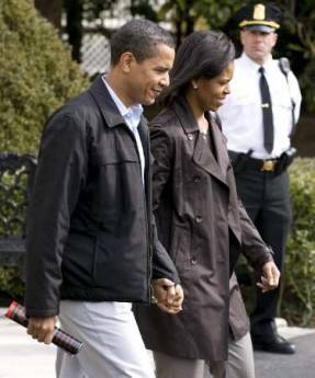 President Barack Obama and First Lady Michelle Obama walk across the South Lawn of the White House holding hands as they depart for an overnight stay with family at the presidential retreat at Camp David on March 7, 2009.