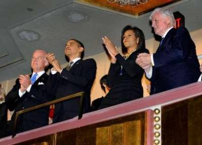 President Barack Obama, First Lady Michelle Obama, and Vice President Joe Biden attend the Celebration Concert for Senator Edward Kennedy's 77th Birthday at the Kennedy Center in Washington, DC on March 8, 2009.